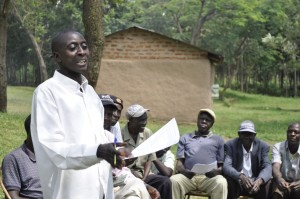 A One Acre Fund field officer trains farmers on planting in Kenya.